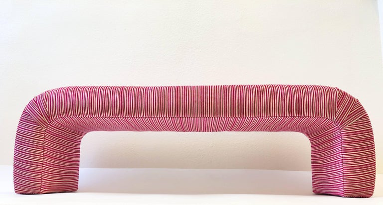 A glamorous 1980s newly reupholstered waterfall bench by Steve Chase. The bench has been upholstered fushia and off-white striped soft velvet (see detail photos). If you wish to have it recovered n a different fabric? Lease let us