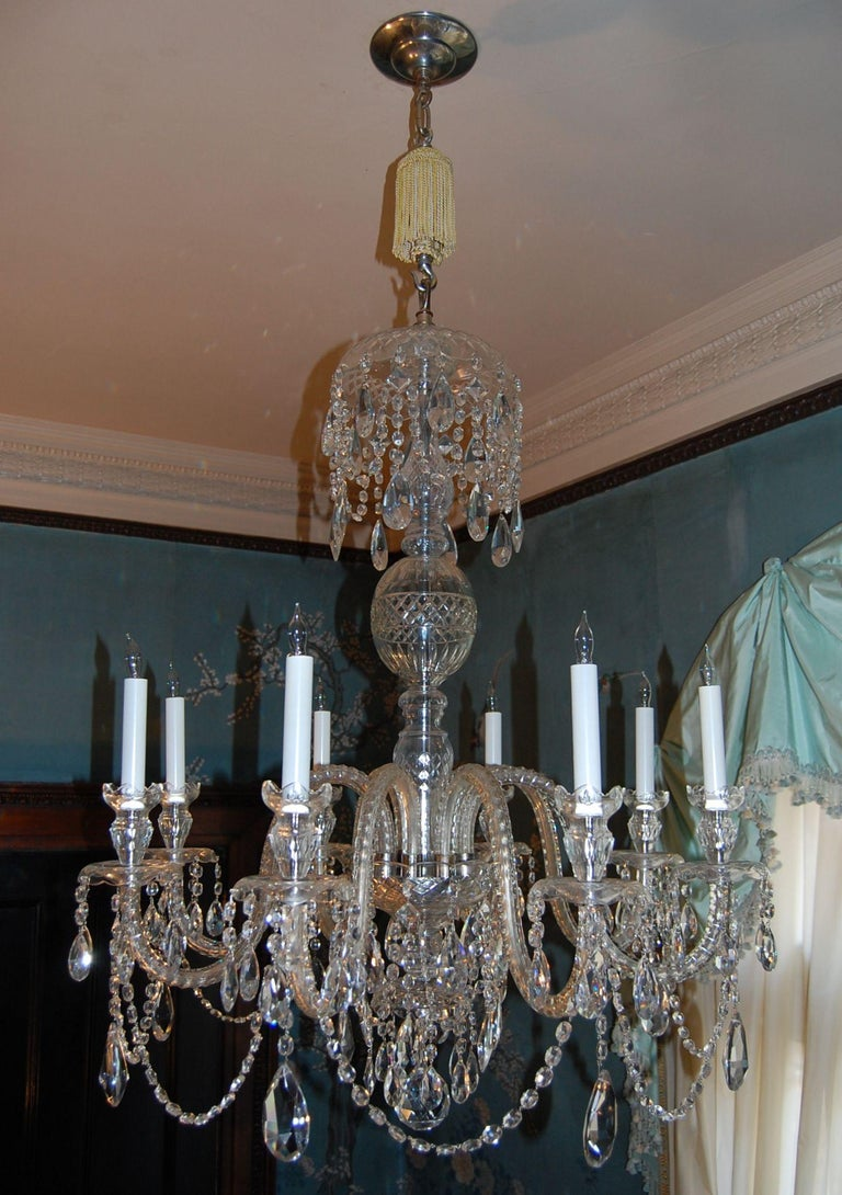 Waterford style eight-light chandelier, recently cleaned and rewired with custom silk tassel, hook and canopy, measures 42