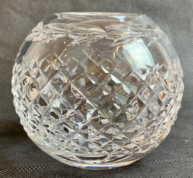 Waterford's glandore pattern cut lead crystal rose bowl. The bowl has pineapple cutting on the sides. The top portion of the bowl has deeply cut leaves in a horizontal pattern. Discontinued in circa 1976.