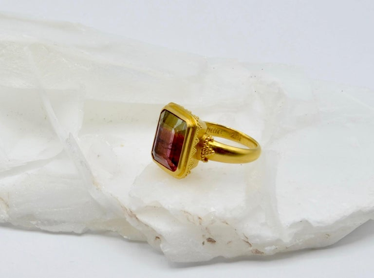 This stunning watermelon 9.3 carat tourmaline is set in 22 karat gold with a delicate beading detail. It has deep raspberry to emerald green shading that is mesmerizing. The ring is a size 6 1/2 and can be sized.