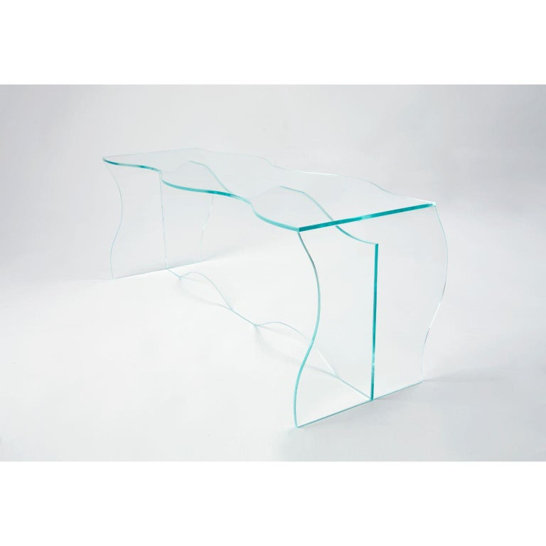Wave clear glass coffee table sculpted by Studio-Chacha Dimensions: 40 x 110 x 40 cm Materials: Clear glass   Studio-Chacha is a high-end art furniture studio founded in 2017 that creates a new aesthetic with an unfamiliar combination of