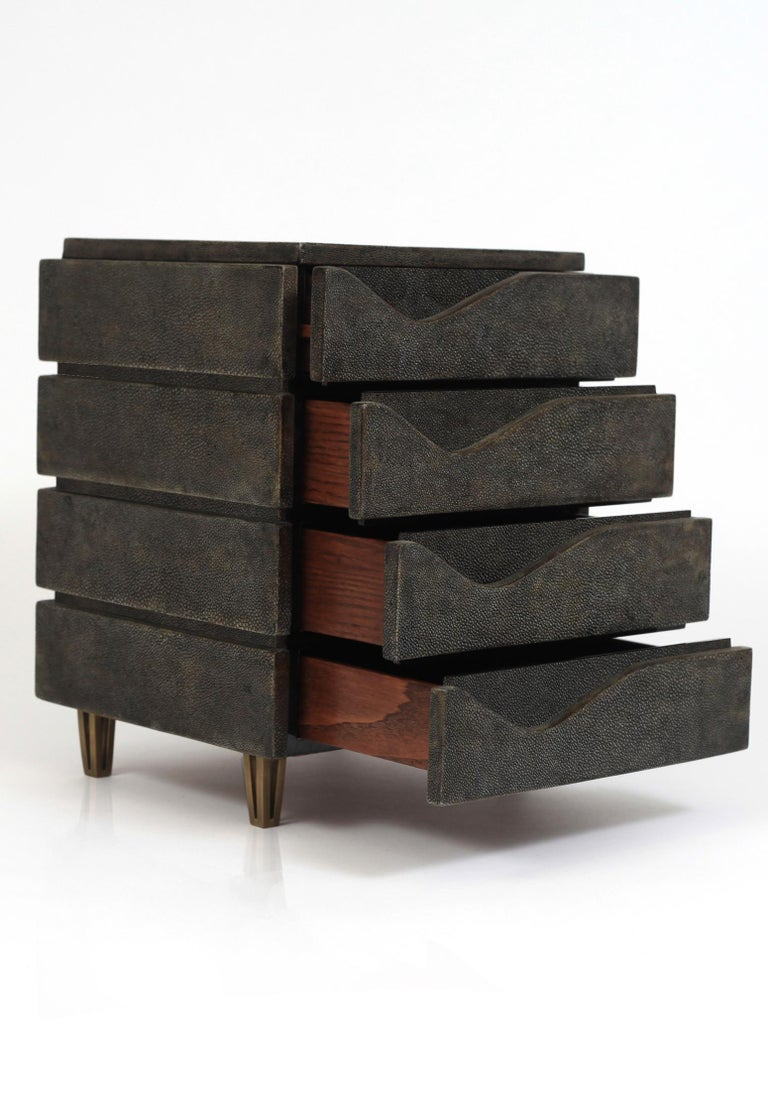 The Wave jewelry chest in black shagreen by R&Y Augousti is a stunning geometric piece to store your personal items. This piece has 4 drawer compartments and sits on 4 bronze-patina brass legs. See images at end of slide of other jewelry chests by