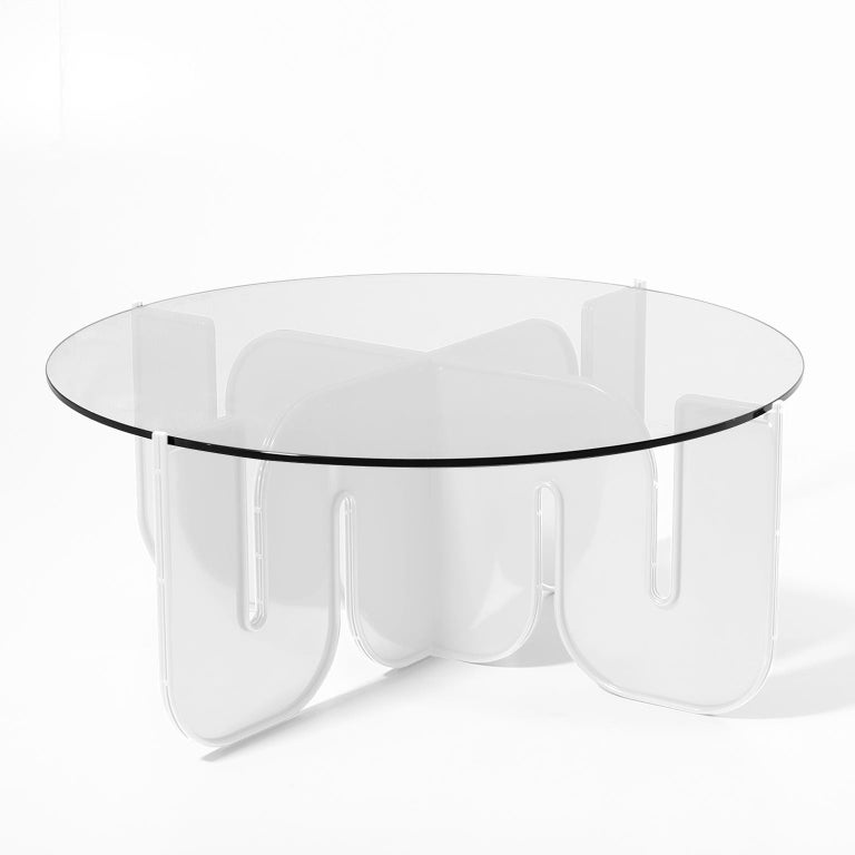 This unique piece, crafted with sheet metal is for all design lovers who want a table as wild and free as the ocean. Add the smoked glass top for an extra unique look, or go with the clear glass for a more chic style.