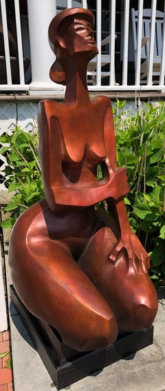 """Augusta 6/12"" Bronze sculpture of a nude woman kneeling in deep orange patina"