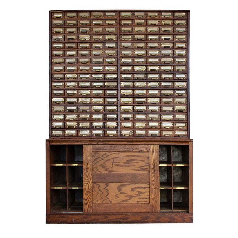 The W.C. Heller Company began manufacturing Industrial furniture in 1891 and is still operational today. This phenomenal cabinet is trademarked with the Montpelier, OH location, which puts its date of production sometime after 1906. It is a