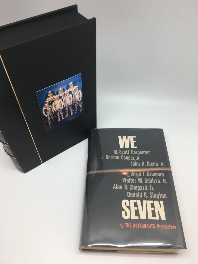 Carpenter, M. Scott, L. Gordon Cooper, Jr., John H. Glenn, Jr., Virgil I. Grissom, Walter M. Schirra, Jr., Alan B. Shepard, Jr., Donald K. Slayton. We Seven by The Astronauts Themselves. New York: Simon and Schuster, 1962. Signed by the astronauts.