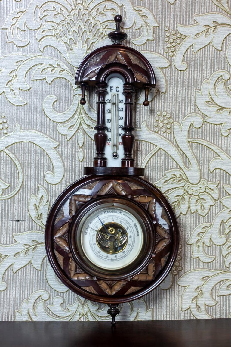 We present you a neat barometer with a thermometer in a walnut case. The whole is dated the 1930s. This item is functional, and displays the pressure and temperature properly. The thermometer shows the temperature in Celsius and Fahrenheit.  The