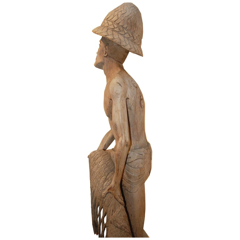 Weathered Wood Fisherman Sculpture For Sale