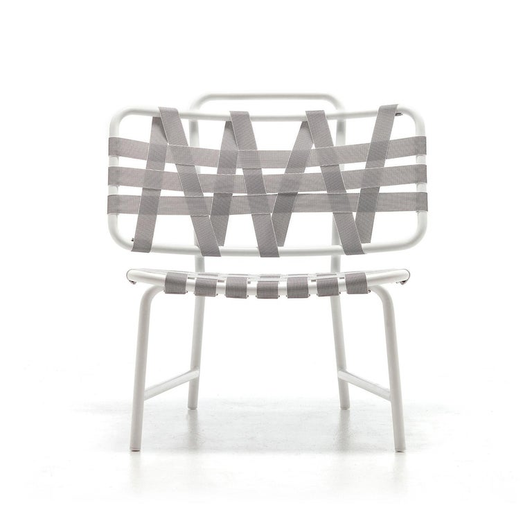 Chair Weaving with aluminium structure in white lacquered finish. Seat and back made with light grey elastic belts. Indoor or outdoor use. Also available with structure in blue lacquered finish with blue elastic belts or with structure in dark