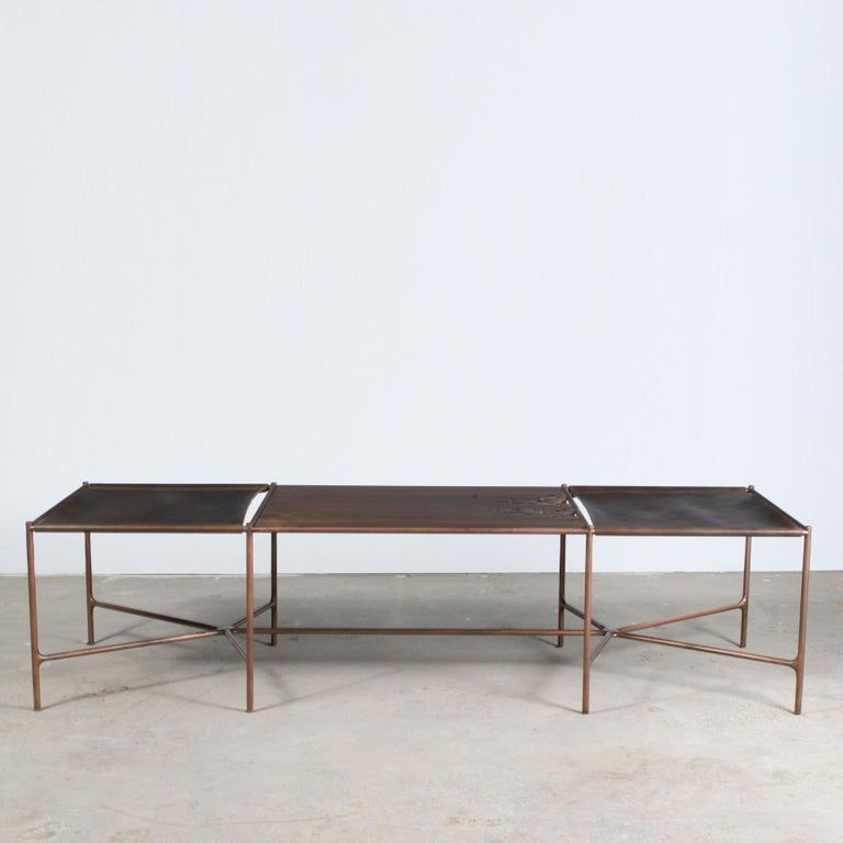 Oiled cast bronze, saddle tanned leather, and organic oxidized walnut.   Designed by master craftsman Jacob Wener, through his company Modern Industry Design, this bench is one of the first iterations of his Web Series. The cast bronze base serves