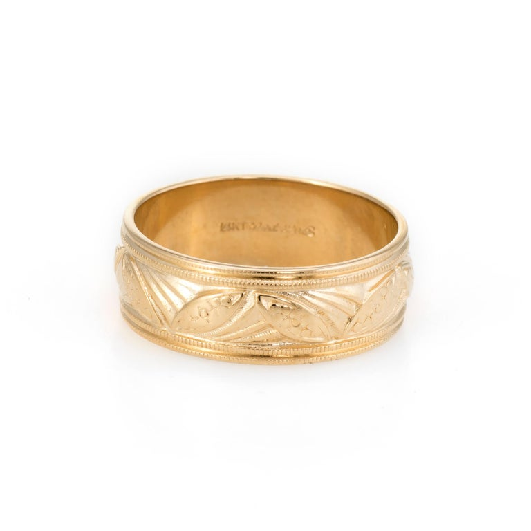 Elegant vintage wedding band, crafted in 14 karat yellow gold.   The band features fine mille grain and navette embossed detail that is continuous around the band.     The ring is in excellent condition.   Particulars:  Weight: 4.1 grams  Stones: