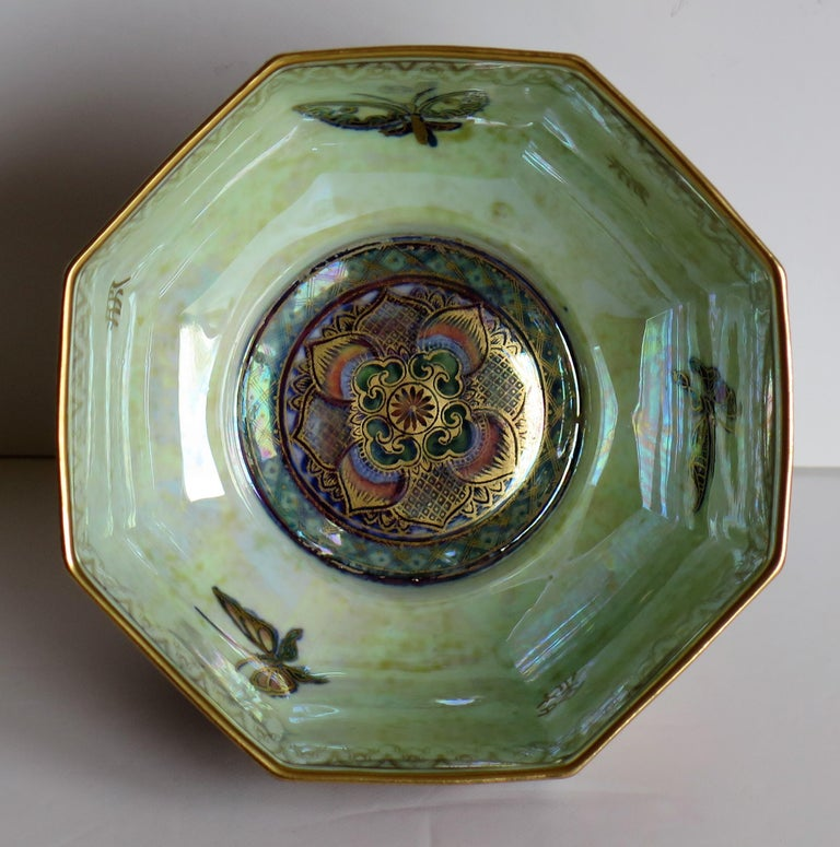 This is a high quality Art Deco period, porcelain octagonal Bowl from the Fairyland Lustre range, pattern Z4827, designed by Daisy Makeig-Jones and made by the Wedgwood factory, England, circa 1925.