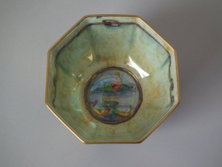 Wedgwood Fairyland Lustre octagonal bowl decorated with 'Firbolgs' design on ruby lustre to exterior, 'Thumbelina' design to the interior. 'Roseberry Bead' border to the foot rim. 'Portland Vase' backstamp and pattern number Z5200 to the underside.