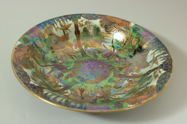 Wedgwood Fairyland Lustre Lily Tray, shape number 2483. Decorated with 'Garden of Paradise' pattern to interior, 'Flight of Birds' to exterior. 'Pebble and Grass' border to exterior rim and foot rim. Maker's marks painted pattern number Z4968.