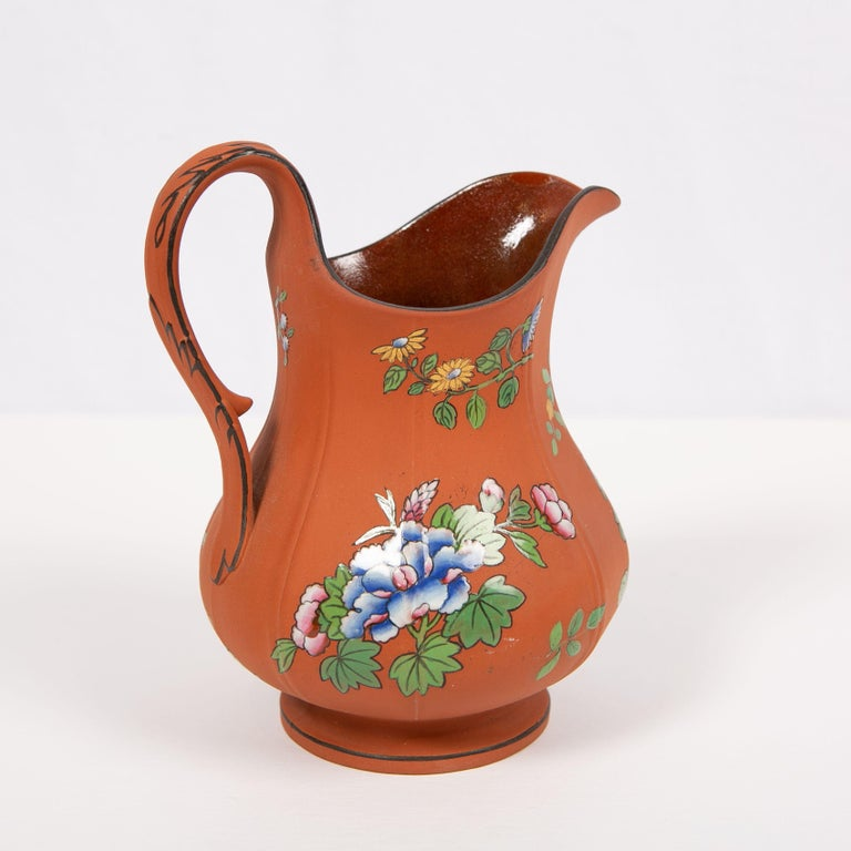Romantic Wedgwood Pitcher Made of Rosso Antico Stoneware Painted with Enameled Flowers For Sale