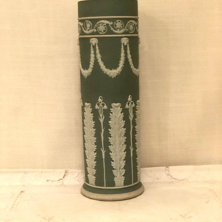 English Wedgwood Tall Green Vase Decorated with Rams Heads and Lilies of the Valley For Sale