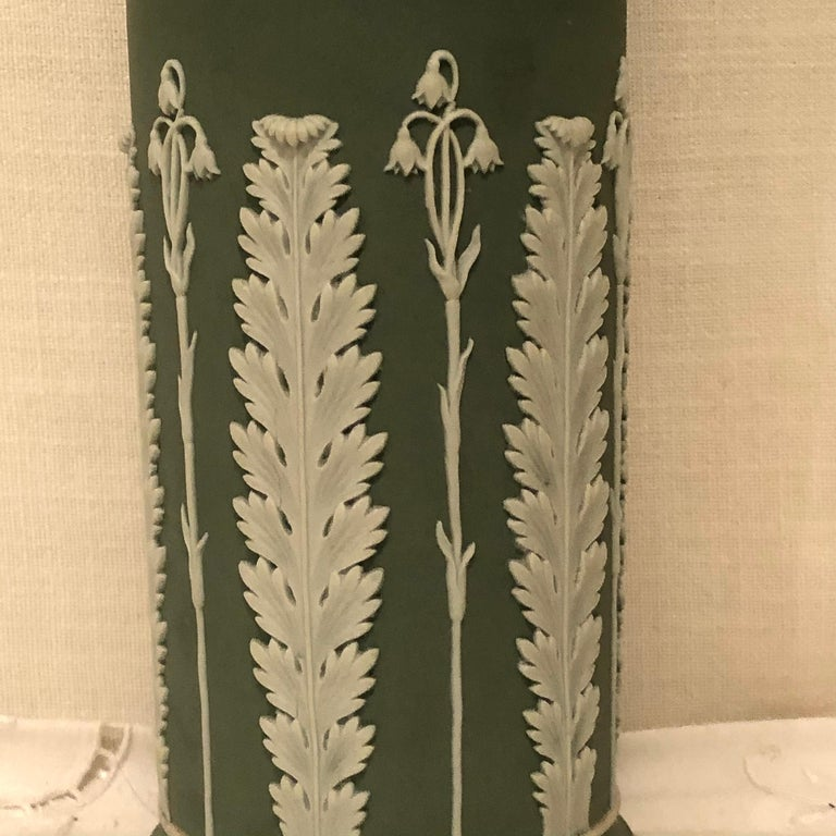 Molded Wedgwood Tall Green Vase Decorated with Rams Heads and Lilies of the Valley For Sale