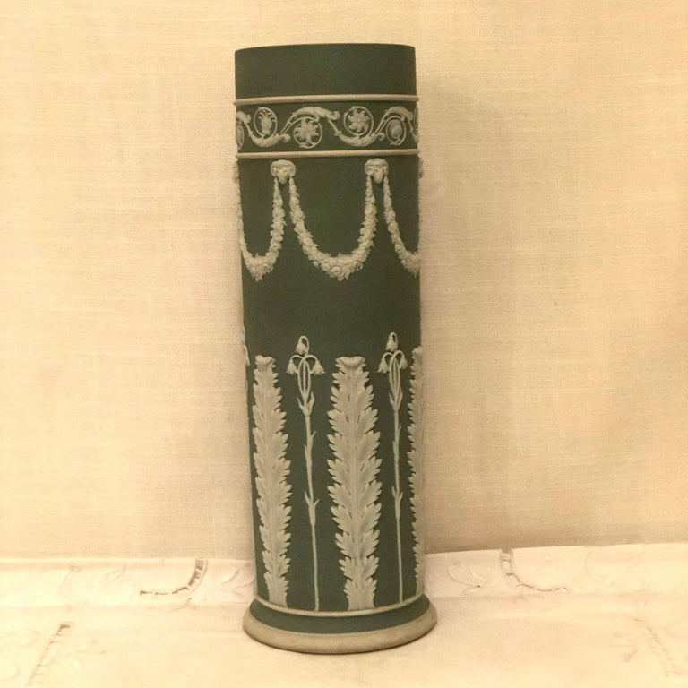 Late 19th Century Wedgwood Tall Green Vase Decorated with Rams Heads and Lilies of the Valley For Sale
