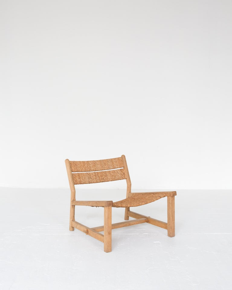 A rare first edition of the rush weekend chair by Pierre Gautier-Delaye as displayed at the