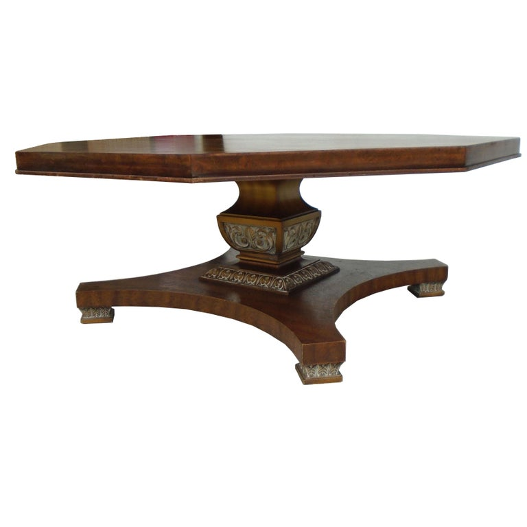 Weiman octagon shaped coffee table.  A mid-century octagonal top coffee table by Weiman. Walnut frame features an eight-sided top on a carved pedestal base with gold and silver accents.  The underside is stamped Weiman.