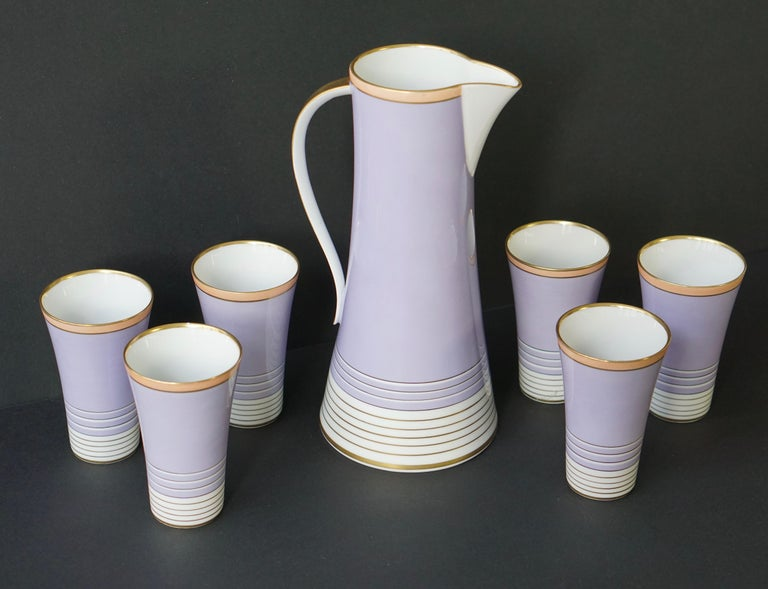 Drinking set composed of a jug and six glasses in violet, white and gilt. The jug and glasses are signed, Weimar porzellein, Germany, Romeo.