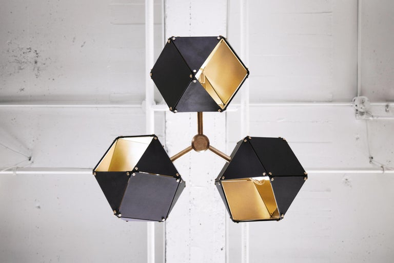 Made up of a sequence of interconnected geometric shapes, the Welles Central chandelier forms sculptural and organic shapes to create a unique silhouette.