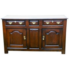 Welsh Georgian Oak Low Dresser with Three Drawers and Two Paneled Cupboard Doors