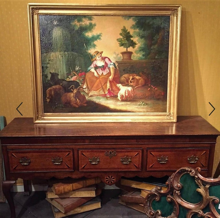 English oak top over a mahogany veneered frieze .Scalloped and sunburst inlaid case encasing three inlaid drawers. Hardware is later antique replacement. Each drawer of oak with mahogany banding and two multicolored spears in each corner.  Top with