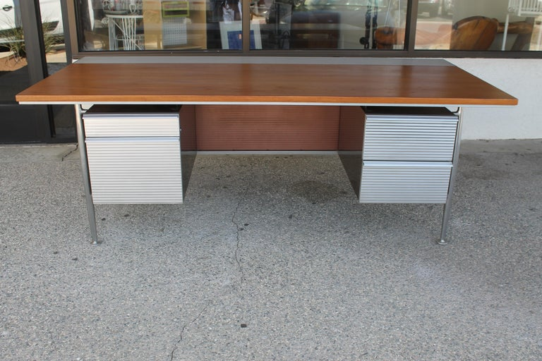 Welton Becket desk for Kaiser Aluminum. Desk is in pristine condition. We just lightly refinished the top. Desk measures: 80