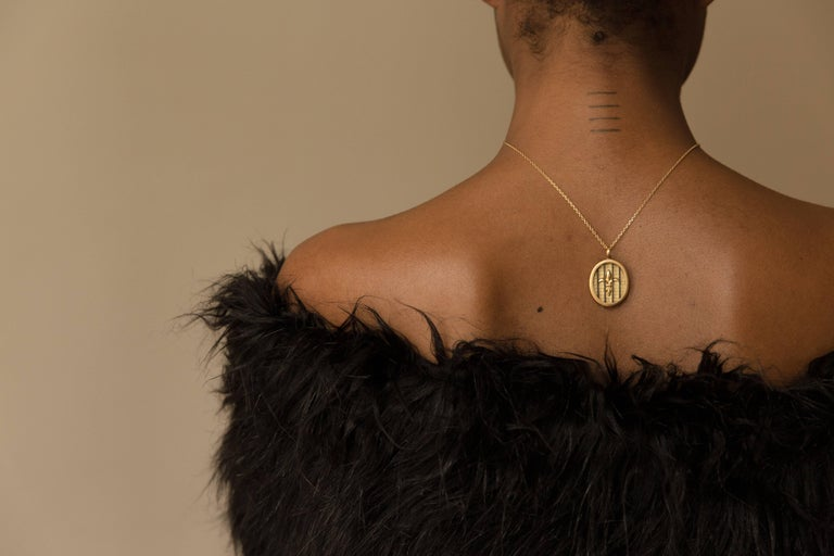 Inspired by Marie Antoinette's daughter, Marie-Thérèse, this hefty oval pendant represents both pain and strength — Marie-Thérèse was imprisoned and mistreated during the French Revolution. She was only 11 when the Bastille was stormed on July 14,