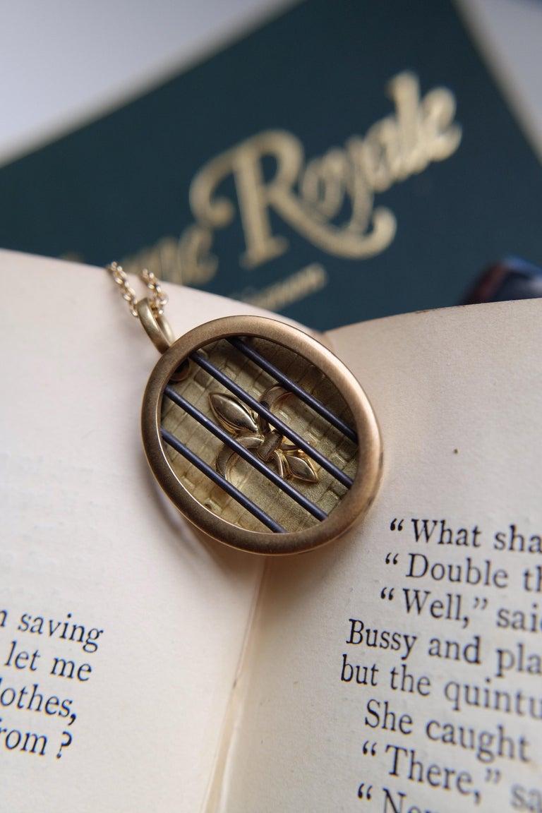 Women's or Men's Wendy Brandes Fleur-de-Lis Yellow Gold Oval Pendant Necklace With Silver Details For Sale