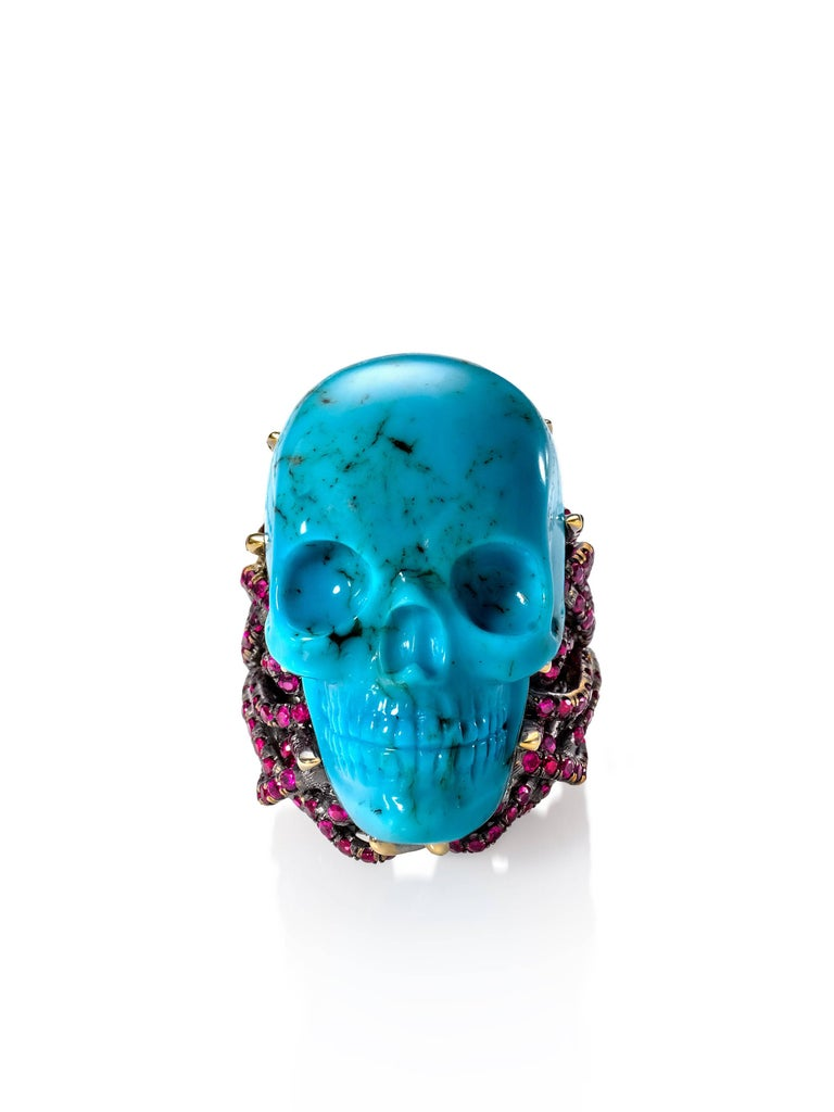 18k yellow gold, satin finish. Hand-carved turquoise skull. 192 custom-cut rubies, totaling 1.94 carats. Size 6. One-of-a-kind. Made in New York City. As seen on supermodel Bella Hadid on the cover of Paper Magazine. As seen on blogger Judith Boyd