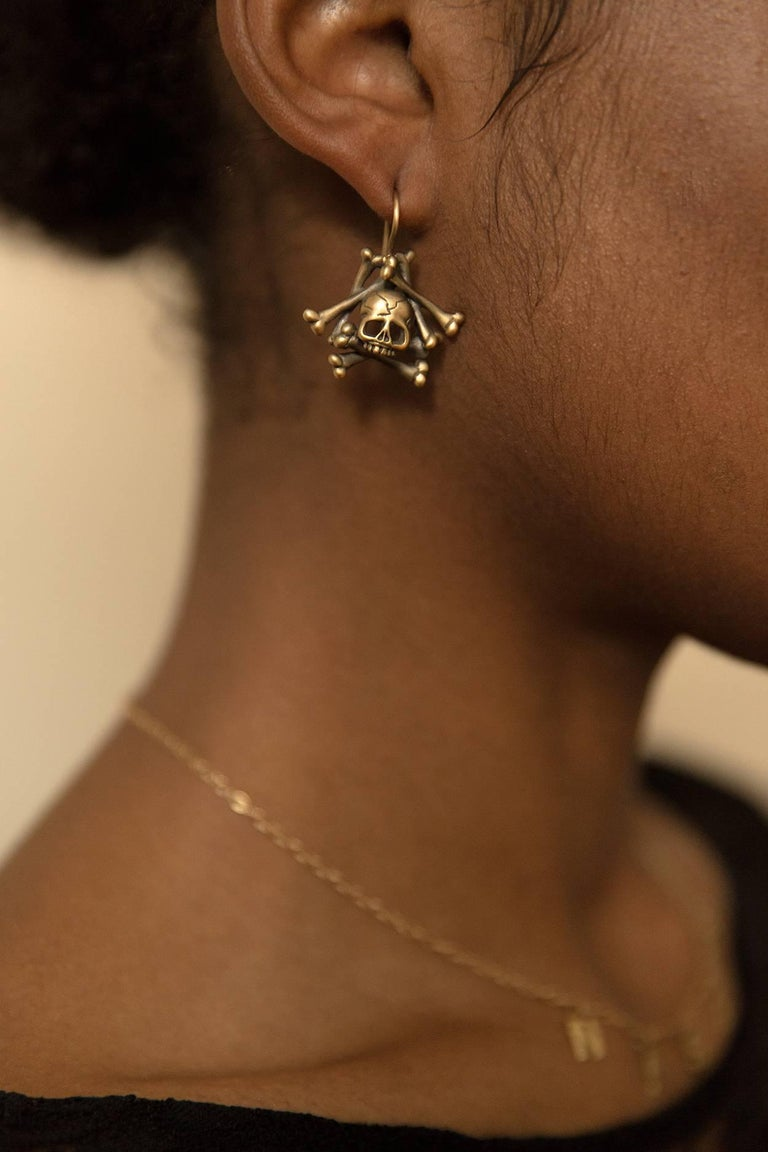 18K yellow gold, satin finish. Black rhodium detail. Limited-edition, number 2. Made in New York City. As seen on supermodel Bella Hadid for Paper Magazine.  Wendy Brandes Gold Collection.  Skull imagery has long been used in memento mori jewelry.