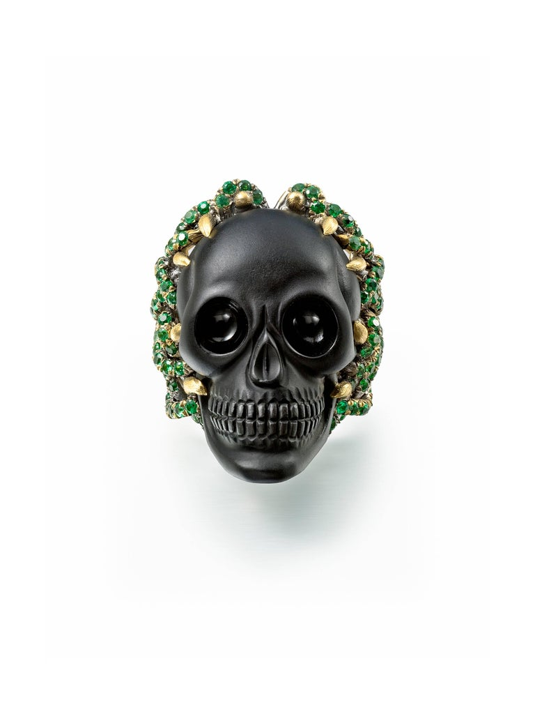 18k yellow gold, satin finish. Hand-carved onyx skull. Custom-cut tsavorites (green garnet), totaling 2 carats. Hidden white diamonds, approx. 7 points. E/F, VS1/VS2. Size 6. One-of-a-kind. Made in New York City.  Wendy Brandes Gold