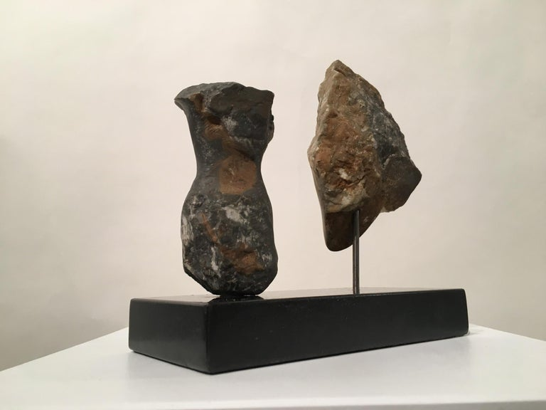 Contemporary American sculptor Wendy Hendelman's alabaster head and torso sculpture on marble base. Hendelman's work reflects her love of the primitive and the ancient. The small scale and style have established her identity as a sculptor as was