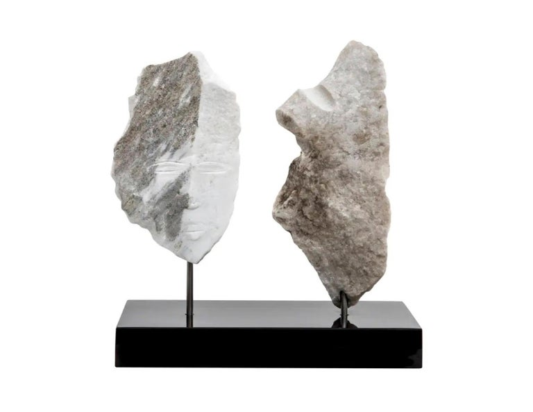 Contemporary American sculptor Wendy Hendelman's Marble Head and Torso Sculpture on a black marble base. Hendelman's work reflects her love of the primitive and the ancient. The small scale and style have established her identity as a sculptor as