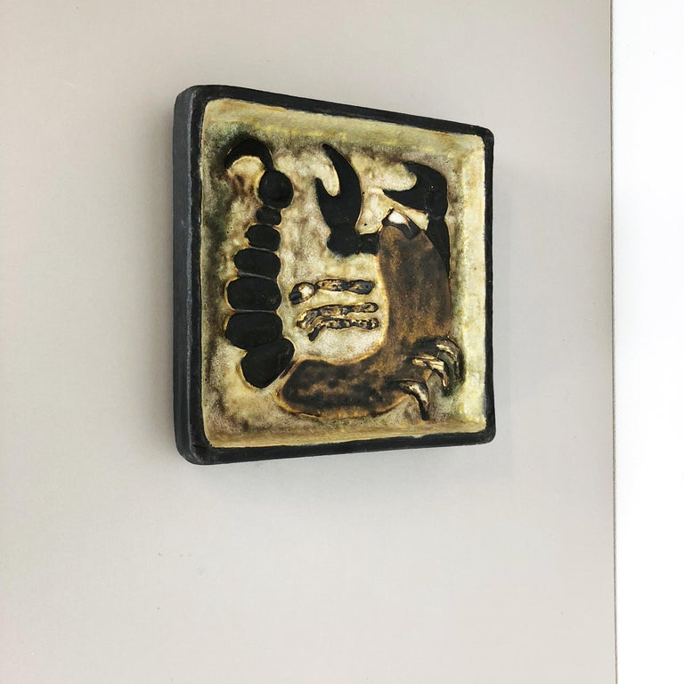 Article:  Ceramic wall plate   Decade:  1960s   Producer:  Atelier Schäffenacker, Ulm Germany   Design:   Helmut Schäffenacker   This original vintage ceramic wall plate with abstract hand-painted and colorful illustrations of a