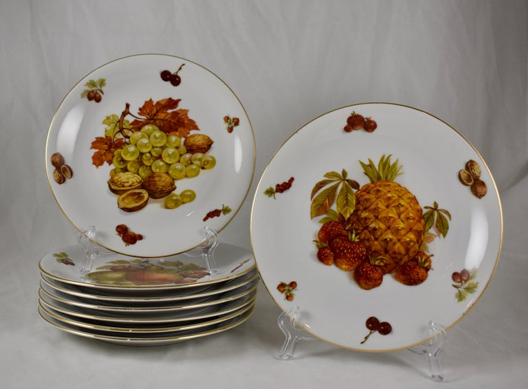 A set of eight porcelain fruit themed plates, made by Selten Weiden K., Bavaria, West Germany, circa 1949-1955.  Central images feature: Pineapple, (1) grapes, (1) red apples, (1) yellow pears, (2) and green pears, (3)   Each image shows the