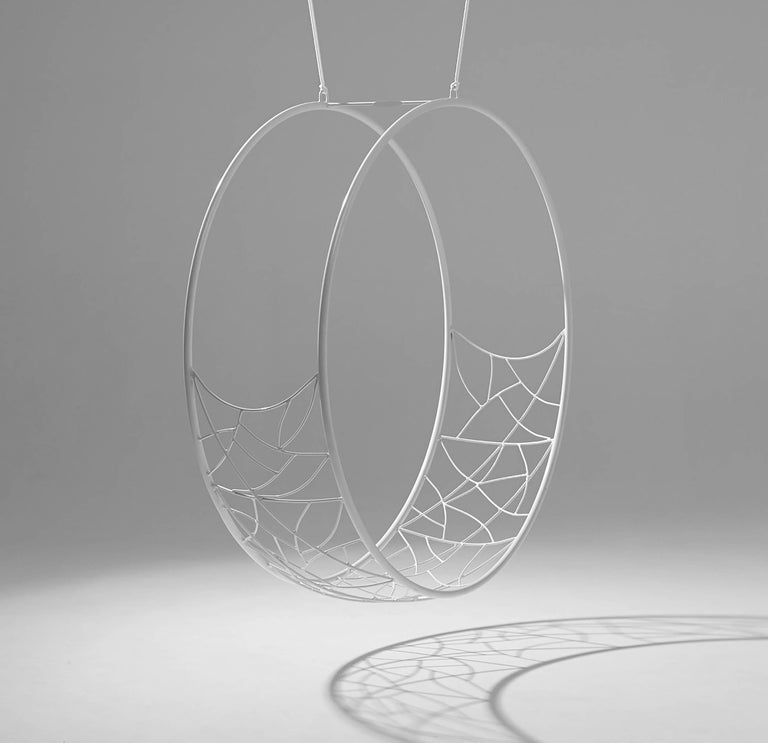 The Wheel hanging swing chair is sculptural and dynamic. Its striking circular shape lends itself for use as a functional art piece.