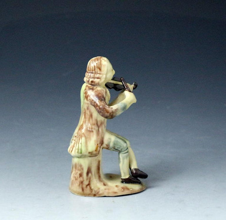 Whieldon-Astbury Pottery Figure of a Violinist Staffordshire, Mid-18th Century In Good Condition For Sale In Woodstock, OXFORDSHIRE