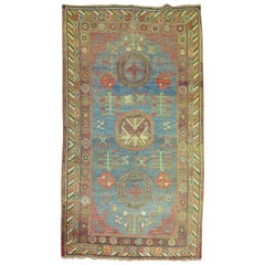 Whimisical Blue Early 20th Century Khotan Antique Rug