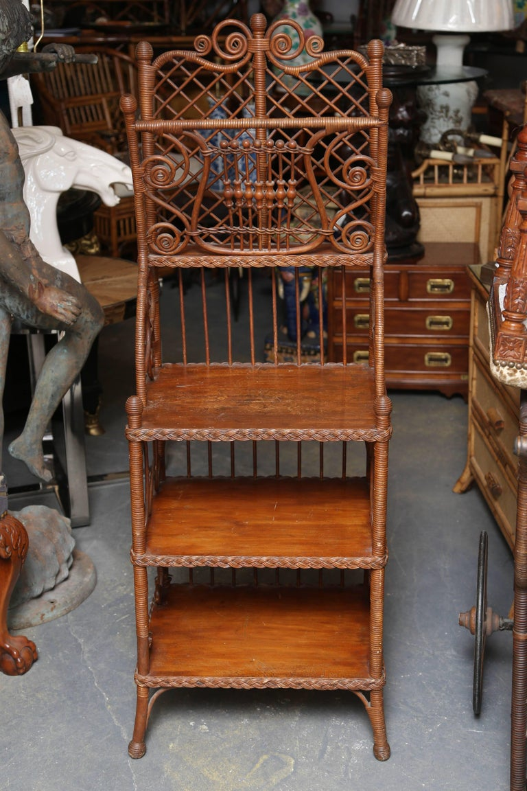 Possibly Heywood-Wakefield with superior elaborate design and workmanship. 