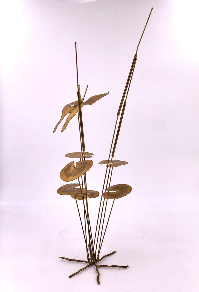 Simple and beautiful welded brass sculpture of a butterfly flying over flowers. unsigned circa 1970s well-done piece signed by D.S Hillet we cant figure the signature.