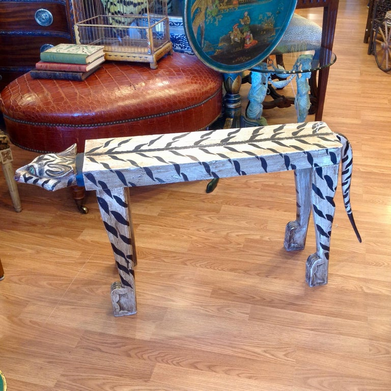 An amusing and charming folk art bench of a not so menacing tiger. Perfectly wonderful. (Measurements include tail). Bench seat measures 28.5