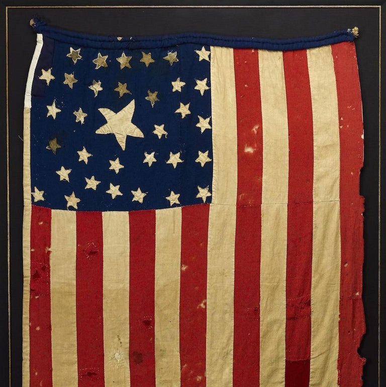 This is an unique and incredibly unusual flag where the finished side of the canton has 33 stars, yet the reverse has 35 stars. Close examination of the canton fabric reveals that no stars appear to be missing, indicating this intriguing star