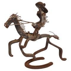 Whimsical Folk Art Horseshoe Sculpture of a Cowboy and Horse