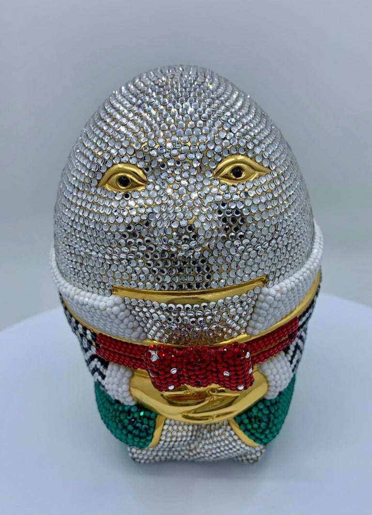 Sure to put a smile on anyone's face, you can expect the unexpected when you carry this whimsical handmade couture designer, Judith Leiber, Humpty Dumpty minaudiere evening bag! Totally covered in dazzling hand set multi-colored crystals over a gold