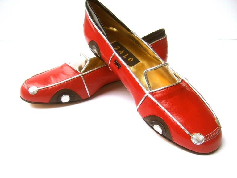 Whimsical red leather sports car design shoes by Zalo US SIze 9 M  The charming car theme flats are constructed with smooth red leather Accented with silver leather piping trim; silver headlights and hubcaps  The windshield is designed with a clear