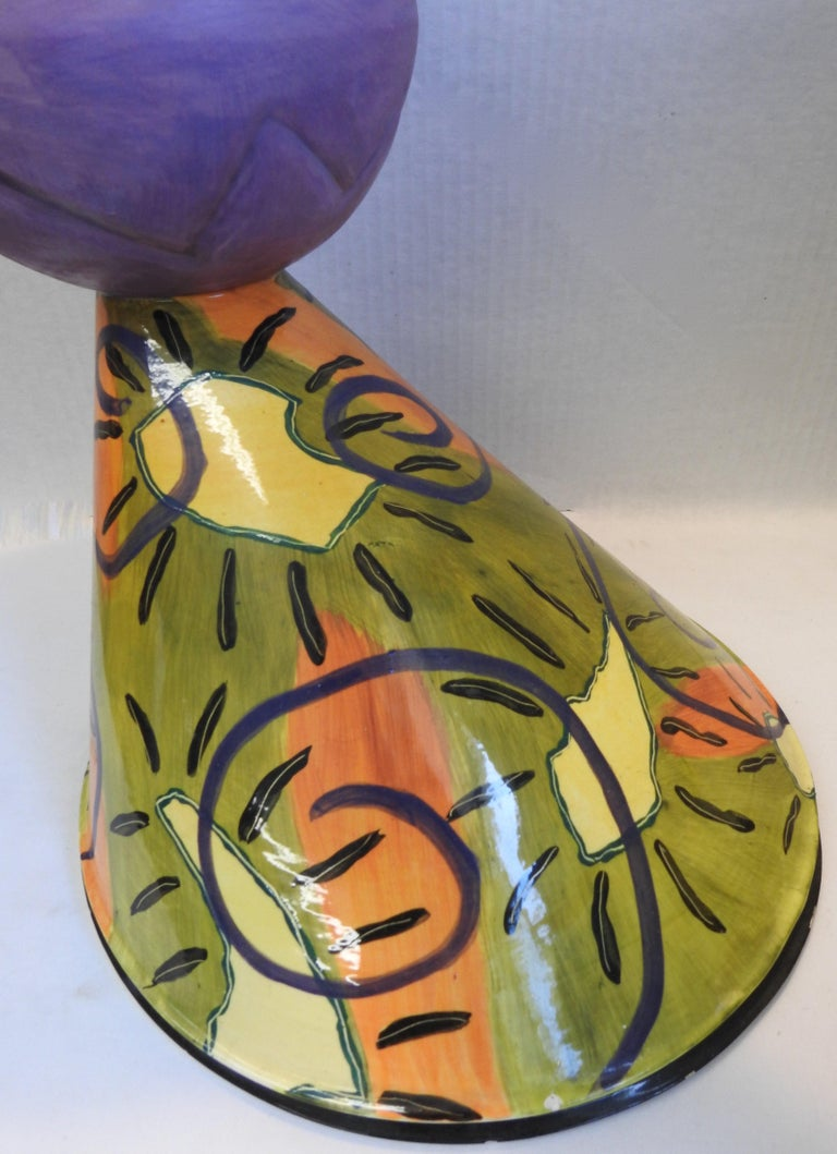 Marilee Hall is well known for her whimsical pottery. She has used vibrant colors on this unusual vase that will be stunning in your surroundings.