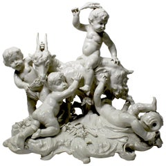 Whimsical White Glazed Porcelain Group of Four Putti Playing with a Goat